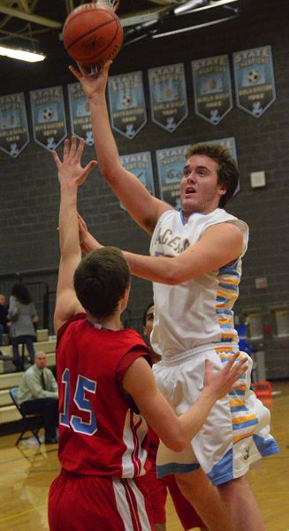 by: VERN UYETAKE - Patrick Jaco puts up a shot in Lakeridge's play-in victory over Centennial last week.