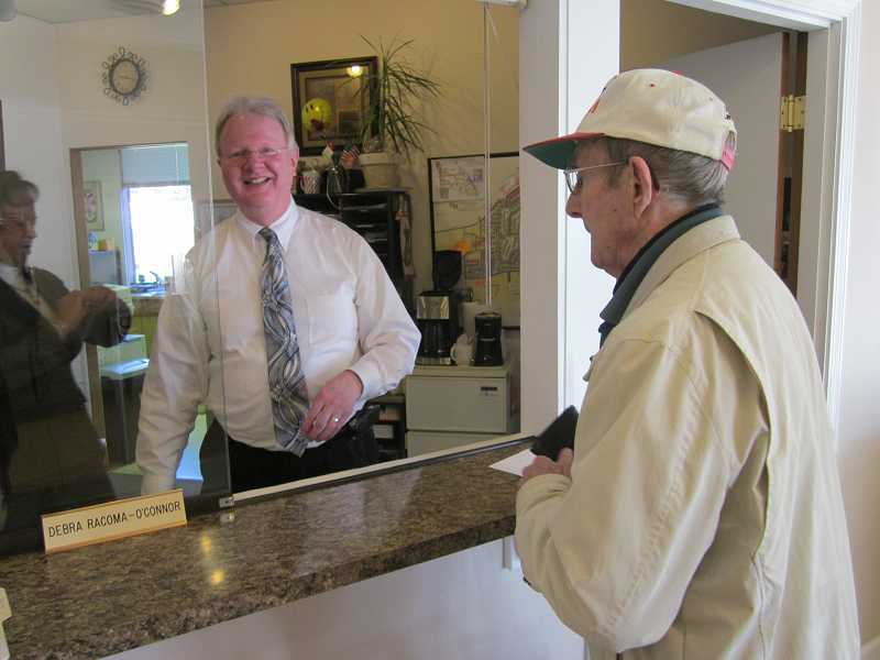 by: BARBARA SHERMAN - SERVICE WITH A SMILE  - KCCA Administrator J. Patrick Moore (center) and Debra Racoma-O'Connol (in background) were busy Feb. 19 exchanging keys with residents like Gar Donnelson