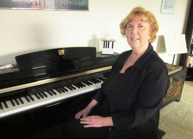 by: BARBARA SHERMAN - LIKE AN OLD FRIEND - Nancy Vink, dressed in a concert-ready outfit, still loves playing the piano, which was the first instrument she learned to play as a child.