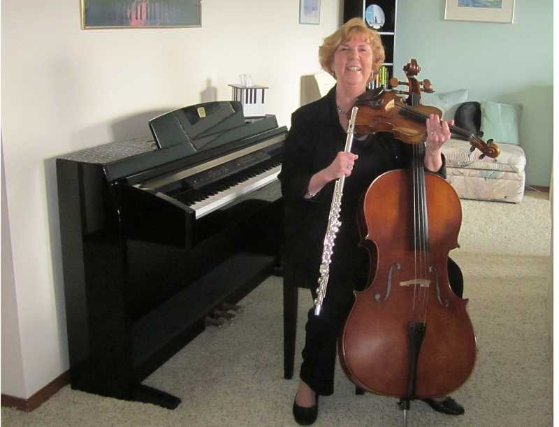 by: BARBARA SHERMAN - SURROUNDED BY MUSIC - When Nancy Vink tries to hold all the instruments she currenly plays, it makes quite a handful.