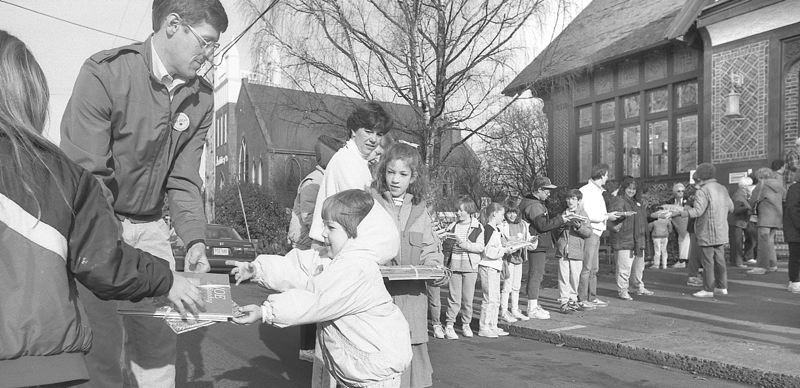 by: OUTLOOK FILE PHOTO 1989 - On December 30, 1989 Gresham citizens lent a hand -- literally -- when the library moved from the  Carnegie building on Main Avenue to the new library on Northwest Miller Avenue. The books were passed hand-to-hand between the two buildings.