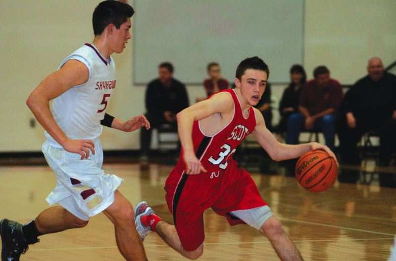 by: THE OUTLOOK: DAVID BALL - David Douglas' Kaeden Speer dribbles around Southridge defender Kevin McClean during the Skyhawks 53-51 win Friday night.