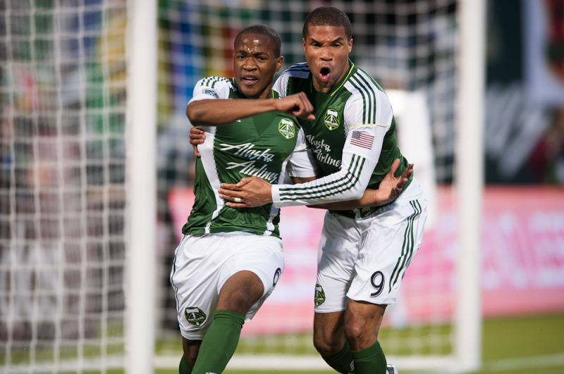 by: TRIBUNE PHOTO: NICK FOCHTMAN - Darlington Nagbe (left) celebrates his goal - Portland's second - with teammate Ryan Johnson as the Timbers rally to tie the New York Red Bulls 3-3 Sunday at Jeld-Wen Field.