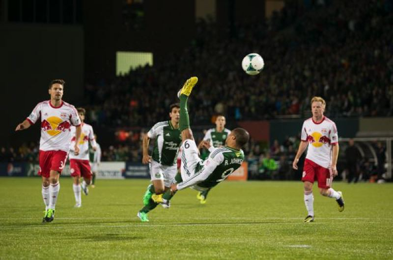 by: TRIBUNE PHOTO: CHRISTOPHER ONSTOTT - Ryan Johnson of the Portland Timbers tries a bicycle kick late in Sunday's MLS season opener against New York at Jeld-Wen Field.