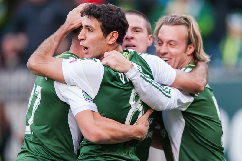 by: TRIBUNE PHOTO: NICK FOCHTMAN - Diego Valeri and teammates exult after his goal for the Portland Timbers tied Sunday's match 1-1.