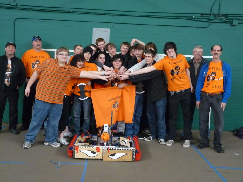 by: PHOTO COURTESY: GHS ROBOTICS - Gladstone High School's robotics team celebrates its completion of a device. The team will again compete against North Clackamas and Oregon City this weekend at Memorial Coliseum.