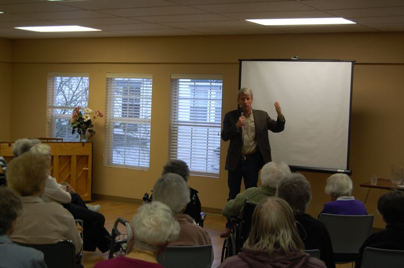 by: PHOTO BY: RAYMOND RENDLEMAN - Congressman Kurt Schrader assures a room crowded with retirees at Clackamas Town Center Village they won't see cuts to their Social Security checks.