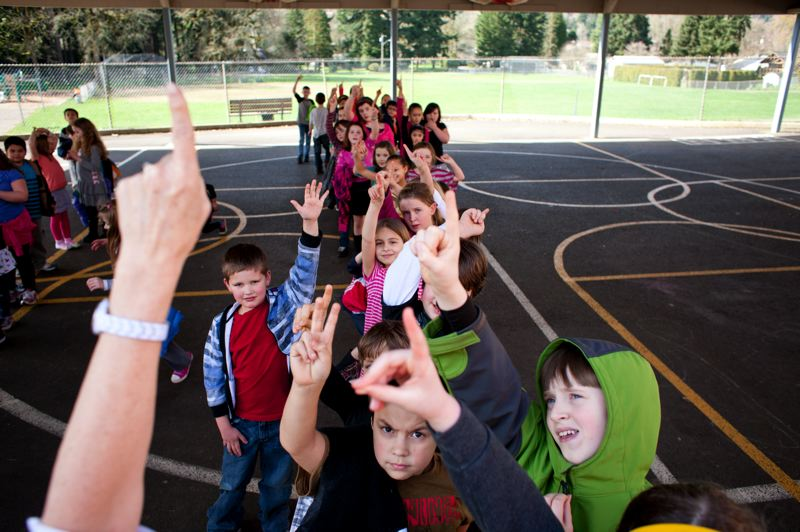 by: PHOTO BY: CHRISTOPHER ONSTOTT - Riverside Elementary School third graders count down from three before heading inside after recess. The school's days may be numbered since a proposed closure will send students to Oak Grove, Concord and the El Puente bilingual program.