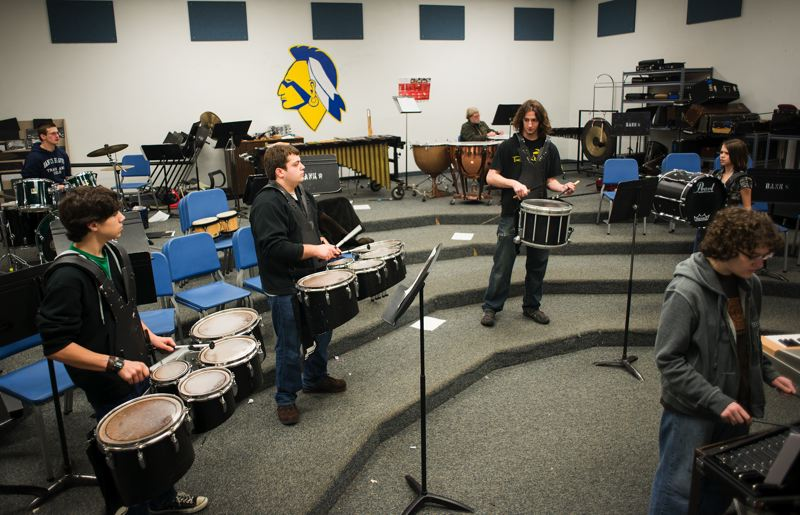 by: NEWS-TIMES PHOTOS: CHASE ALLGOOD - Students in the Banks High School drum line take direction from student leader Brian Lacock (middle, on snare drum). The student-run organization practices several times a week and will compete at three indoor percussion circuit events this winter.
