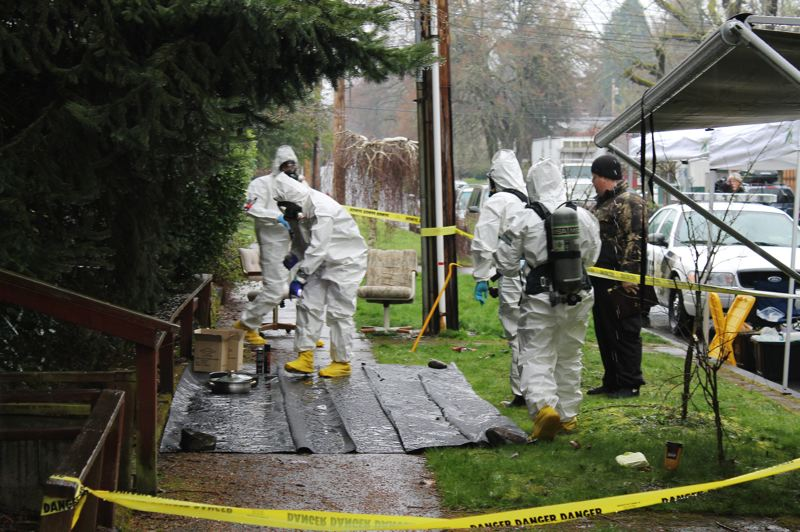 by: NEWS-TIMES PHOTO: JOHN SCHRAG - Evidence removed from a Forest Grove home following an early Tuesday morning explosion was sorted and cataloged on a C Street sidewalk.