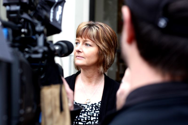 "by: SPOTLIGHT PHOTO: KATIE WILSON - Amy Painter, widow of slain Rainier Police Chief Ralph Painter, answers questions from the media after her husband€sˇÃ""ôs accused killer, Daniel A. Butts, was declared mentally incompetent to go to trial at this time. SPOTLIGHT PHOTO: KATIE WILSON"