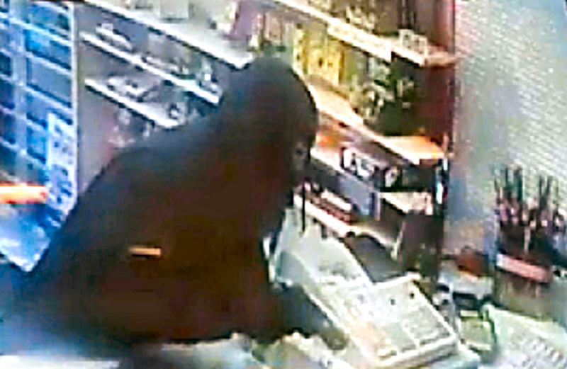 by: (SURVEILLANCE VIDEO) - There's no mistake about it- this man is pointing a very realistic-looking gun at the Brentwood-Darlington convenience store's owner, demanding money.