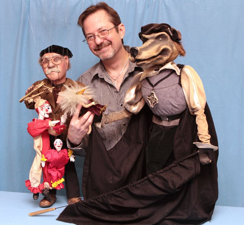 by: DAVID F. ASHTON - Stephen Overton (the human in the middle) shows Hobie Baker's 'Blind Puppeteer' marionette and Janet Bradley's 'Big Bad Wolf' two of the many famous creations featured in this month's 'Puppets of Portland' exhibit in Sellwood.