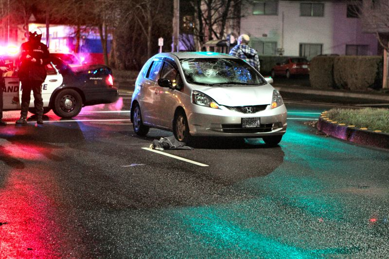 by: DAVID F. ASHTON - The hood and windshield of this Honda Fit are clearly damaged from the impact - which police say happened when a pedestrian stepped right in front of it.