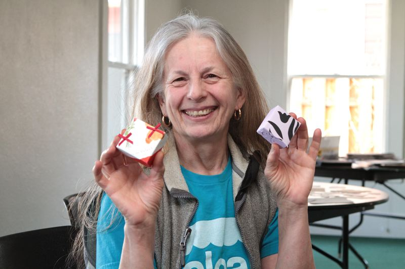 by: DAVID F. ASHTON - Crafty Renee Kimball, a Sellwood resident, shows gift boxes she's fashioned from used greeting cards.