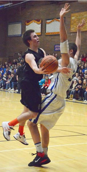 by: JOHN BREWINGTON - Scappoose's Kyle Kramer had a big task against La Salle's Jacob McGraw and he did a good job on both offense and defense.