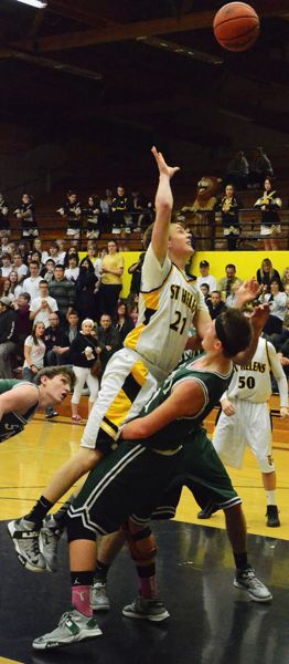 by: JOHN BREWINGTON - St. Helens' Gage Bumgardner leans in for a shot during last week's play-in game with Summit.