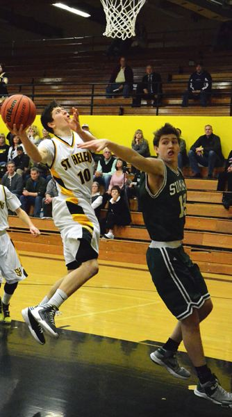by: JOHN BREWINGTON - St. Helens' Tanner Long goes up for a shot during last week's play-in game with Summit.