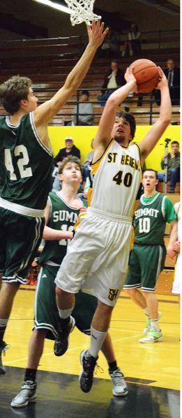 by: JOHN BREWINGTON - St. Helens' Corey West slices along the baseline for a shot during last week's play-in game.