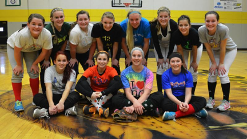 by: JOHN BREWINGTON - Players on the St. Helens High Lady Lions softball team will include: (front, from left) Ashley Giesbers, Michelle Sass, Kayla Finch, Hailee Fischer, (back) Taylor Leal, Alyssa Giesbers, Courtney Anderson, Sue Sass, Kali Moore, Mariah Mulcahy, Karli Edwards, and Stevie Strawn.