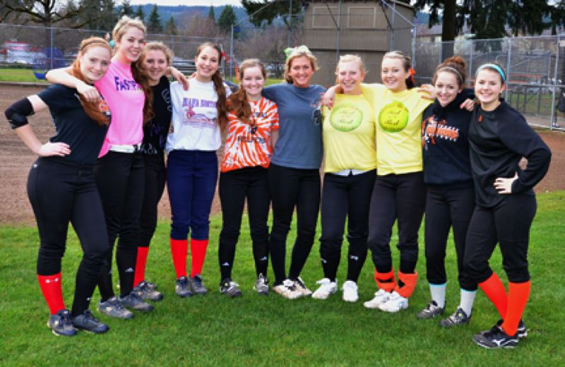 by: JOHN BREWINGTON - Players on the Scappoose High Lady Indians softball team this season include: (from left) Avery Jones, Kendall Bailey, Ashley MacInnis, Jessie Dykes, Shelbie Butler, Sophia Hart, Lexi Courtney, Cassidy Hoglund, Amanda Schlosser, and Lacey Updike. Some players were not available.