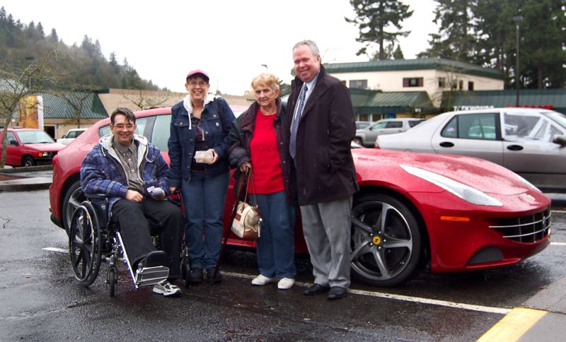 by: CONTRIBUTED PHOTOS: MARQUIS CENTENNIAL - Harold Salsgiver, from left, with his sister Linda Christianson, mother Eileen Burgy and car owner Art Smith of Ron Tonkin Gran Truismo.