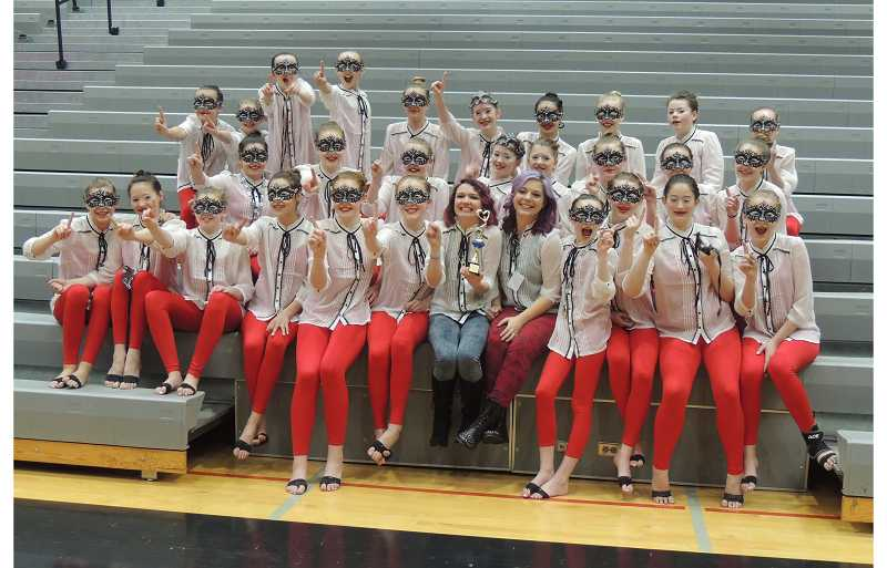 by: SUBMITTED PHOTO - The team poses with its trophy after winning the competition at Oregon City High School.