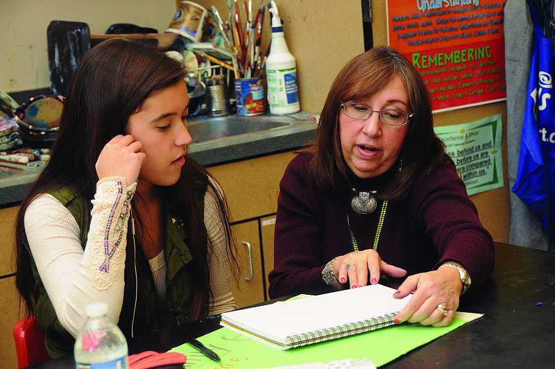 by: TIDINGS PHOTO: VERN UYETAKE - Art teacher Lynn Pass consults with sophomore Emily Gibson.