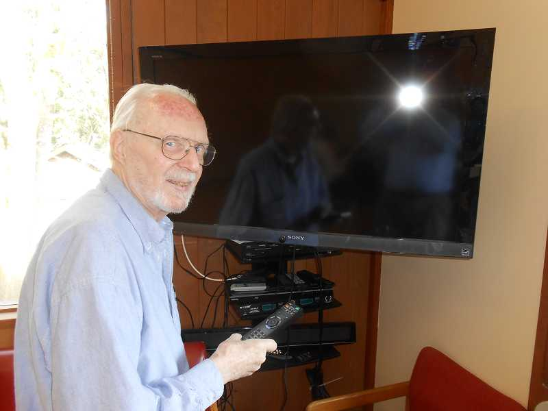 by: CLIFF NEWELL - Frank Woodman is shown at the screen where he exhibits 'The Woodman Chronicles' at the Lake Oswego Adult Community Center. The past was never so fun.