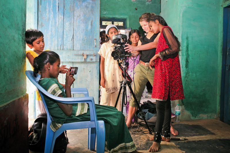 by: COURTESY OF MARTHA ADAMS AND GINA NEMIROFSKY - Girls check video at a World Vision drop-in center in India as part of the film 'Girl Rising,' which follows the lives of young women in nine developing countries.