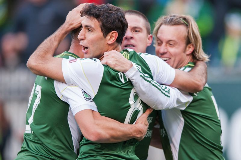 by: TRIBUNE PHOTO: NICK FOCHTMAN - Diego Valeri, Portland Timbers midfielder, celebrates with teammates after scoring the team's first goal of the MLS season in last week's 3-3 draw at home against New York.