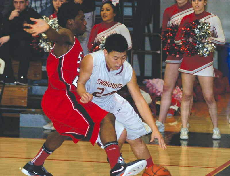 by: DAVID BALL - DRIVING - Southridge's David Kim tries to drive the baseline during his team's Friday-night home win over David Douglas in the second round of the Class 6A state playoffs.