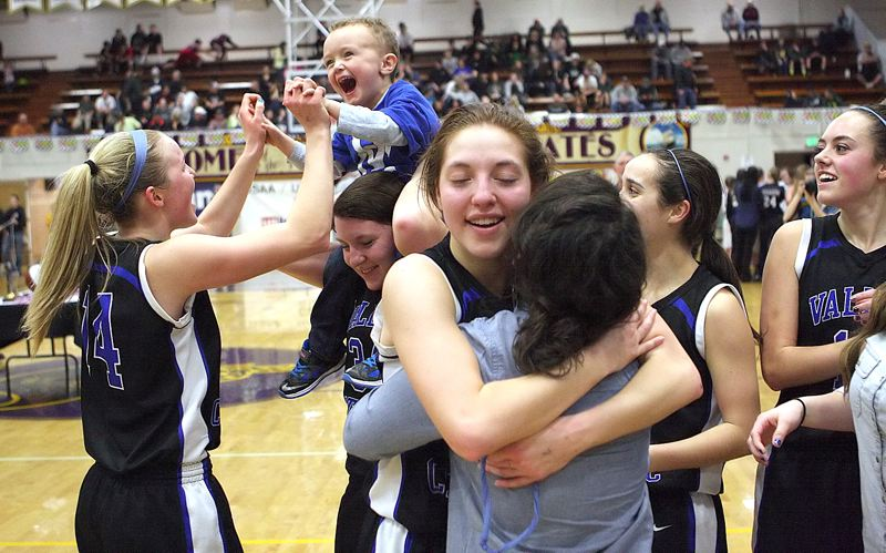 by: MILES VANCE - WE'RE NO. 1 - Valley Catholic's Chelsea Alsdorf hugs teammate Taylor Kinion, while teammate Lindsie LaBonte (left) high-fives Jack Severin (riding on Emily Gabourel's shoulders), and VC's Grace Mannen and Addie Flemmer also celebrate their team's win over St. Mary's.