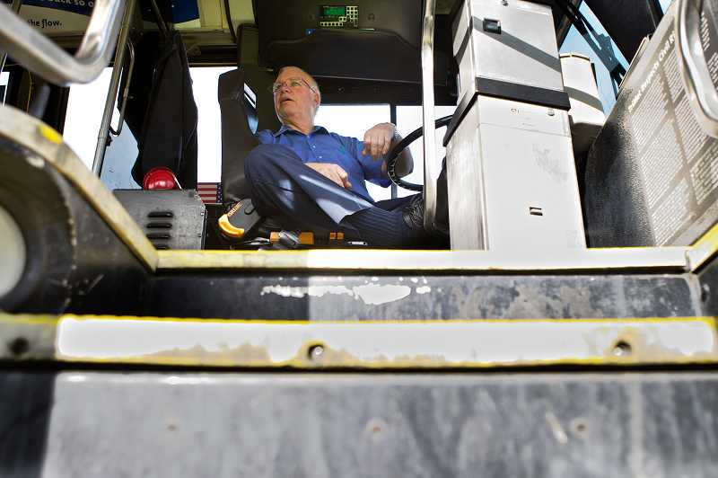 by: TIMES PHOTO: JAIME VALDEZ - TriMet bus operator Rolynd Puckett of Beaverton has been awarded the distinction of Gold Master Operator as part of TriMet's Master Operator Program. Puckett, 62, has been a TriMet bus operator for 38 years.