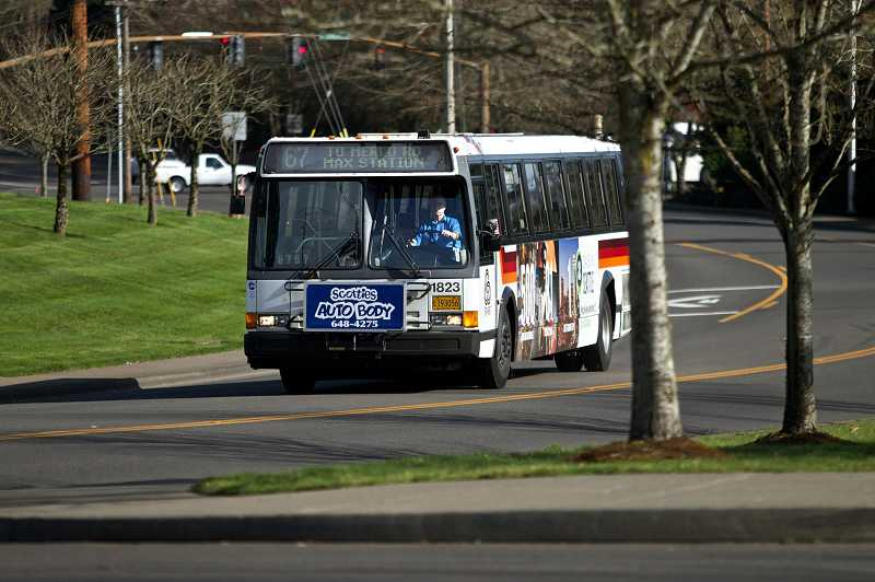 by: TIMES PHOTO: JAIME VALDEZ - TriMet bus operator Rolynd Puckett drives to the next bus stop at Southwest Merlo Road and 158th Avenue on Monday morning.