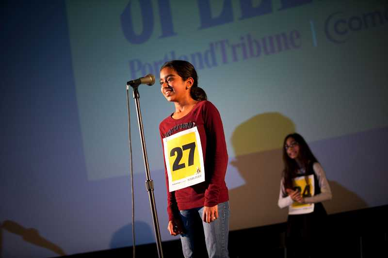 by: TIMES PHOTO: CHRISTOPHER ONSTOTT - Divya Amirtharaj correctly spelled 'rapscallion' and 'hegemonic' to win the ninth annual Portland Tribune/Comcast Regional Spelling Bee Saturday at the Hollywood Theatre.