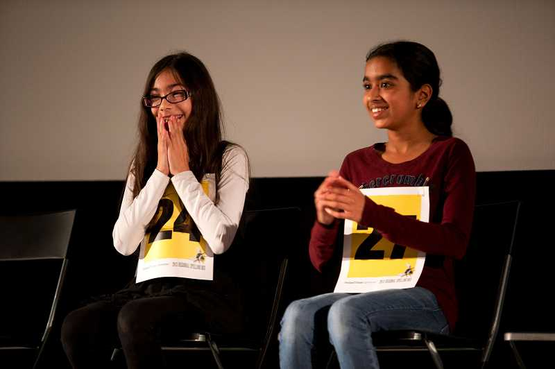 by: TIMES PHOTO: CHRISTOPHER ONSTOTT - Umbre Khan, left, from the Islamic School of the Muslim Education Trust in Tigard and Divya Amirtharaj of Meadow Park Middle School are excited as they head in to the final round of the ninth annual Portland Tribune/Comcast Regional Spelling Bee.