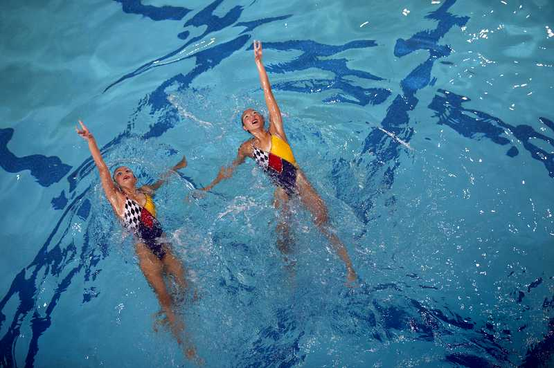by: TIMES PHOTO: JONATHAN HOUSE - Leilah Talukder and Celine Joo of Santa Clara perform their routine during the 2013 Synchronized Swimming Junior West Zone Championships at the Tualatin Hills Aquatic Center.