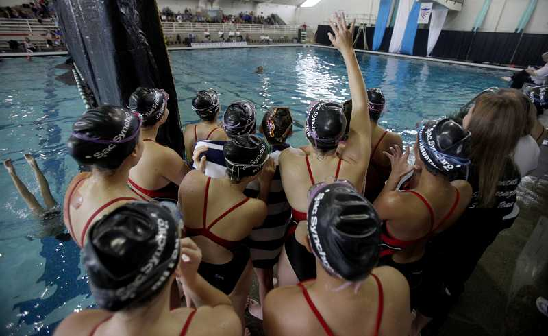 by: TIMES PHOTO: JONATHAN HOUSE - Members of the Sacramento Synchro team cheer on their teammates.