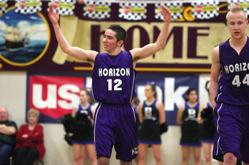 by: MILES VANCE - LET'S HEAR SOME NOISE -- Horizon Christian sophomore guard Trent Pihas rallies the crowd during the Hawks' Class 3A state championship game against Blanchet Catholic. Horizon won 49-26.