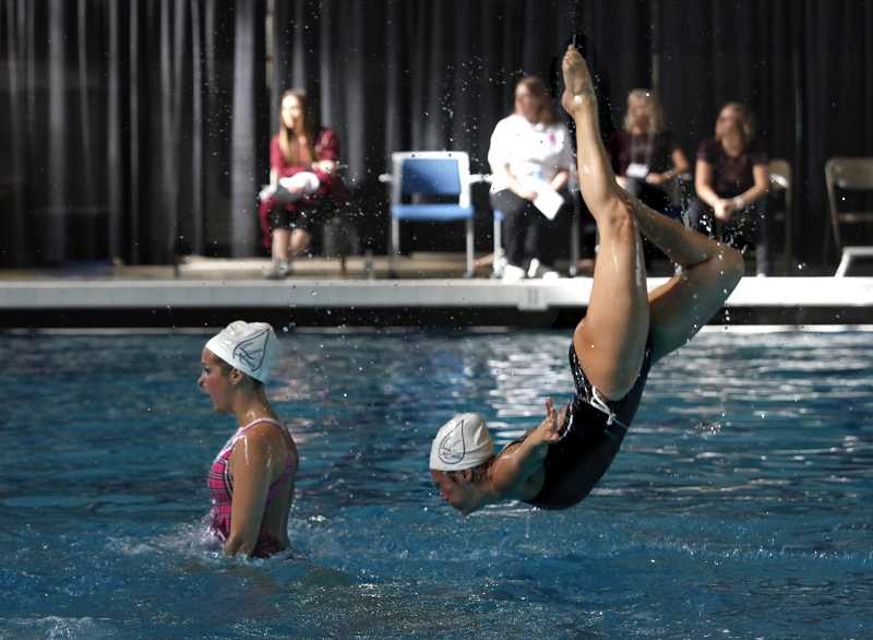 by: TIMES PHOTO: JONATHAN HOUSE - Teammates of the Meraquas of Irvine rehearse their performance in the team combo division of the 2013 Synchronized Swimming Junior West Zone Championships.