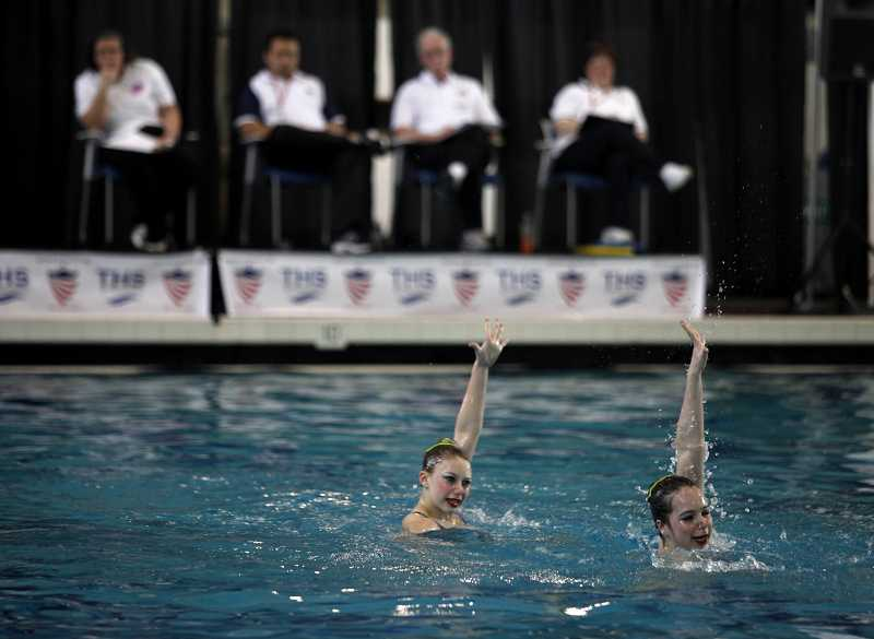 by: TIMES PHOTO: JONATHAN HOUSE - Tualatin Hills Synchro club members Kara Batchelor and Sophie Harrison perform for the judges.