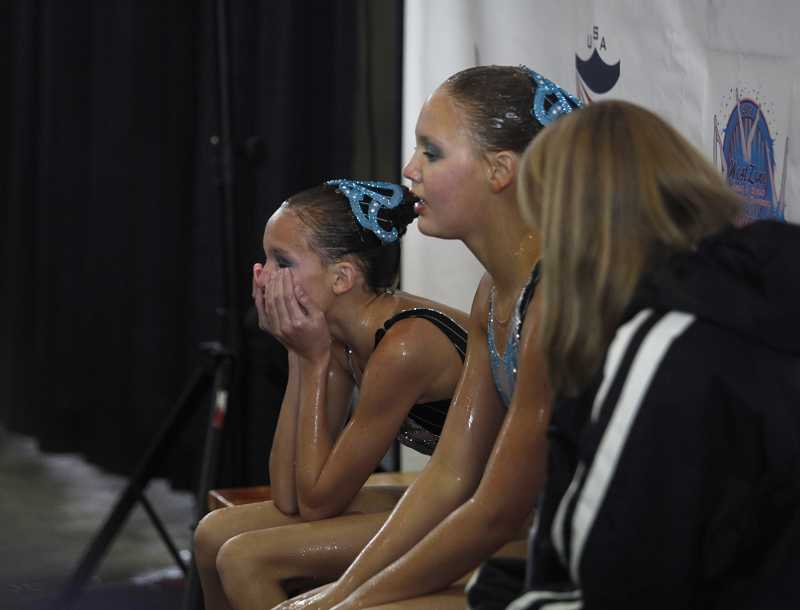 by: TIMES PHOTO: JONATHAN HOUSE - Jordynn Dixon and Eryn Schmisseur try to catch their breaths after a duo performance.