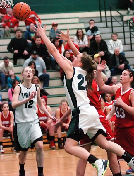 by: DAN BROOD - UP FOR TWO -- Tigard senior Megan Risinger goes up to the basket during the state playoff win over Centennial.