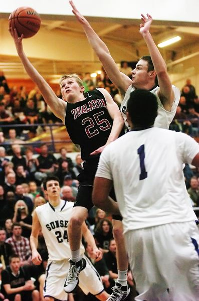 by: DAN BROOD - UP AND AWAY -- Tualatin High School senior Randall Tainer (25) goes up strong to the basket during the second half of the Timberwolves' state playoff game at Sunset.