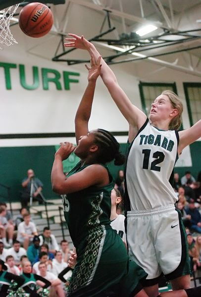 by: DAN BROOD - REJECTED -- Tigard freshman Elise Conroy (right) blocks a shot by Jesuit's Alzena Henry in Saturday's state playoff game.