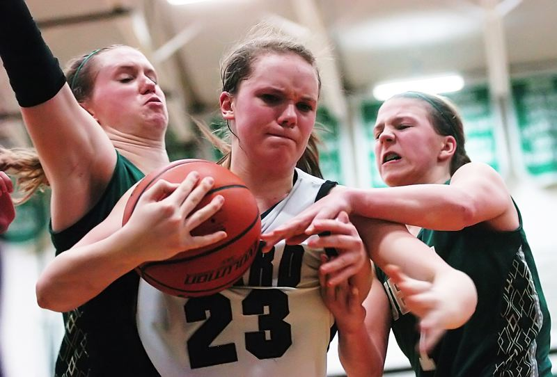 by: DAN BROOD - IT'S MINE -- Tigard senior Megan Risinger keeps the ball away from Jesuit's Lauren Glick (left) and Kate Andersen in Saturday's state playoff game. The Tigers will face Clackamas in a state-tournament quarterfinal game today.