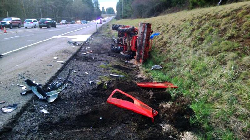 by: CONTRIBUTED PHOTO: OREGON STATE POLICE - CONTRIBUTED PHOTO: OREGON STATE POLICE The small Kubota tractor is seen lying on its side after the victim/driver, in critical condition, had been freed and transported to a hospital Friday afternoon.