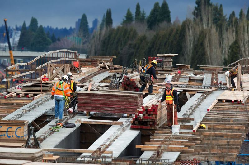 by: PAMPLIN MEDIA GROUP: CHRISTOPHER ONSTOTT - Work on the Portland-to-Milwaukie light-rail line continued in Southeast Portland as TriMet and Clackamas County wrestled with legal issues surrounding the county's obligation to the $1.49 billion project.
