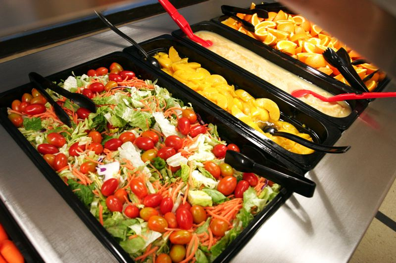 by: OUTLOOK PHOTO: JIM CLARK - The salad bar at Lynch Meadows Elementary School offers healthy vegetables and fruit.